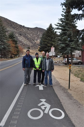 From left to right: Dave Dantas, former Avon Town Council Member; Jim Horsley, Project Engineer; Scott Prince, Avon Town Council Member; and Justin Hildreth, Town Engineer stand at the base of the climbing lane on Metcalf Road.