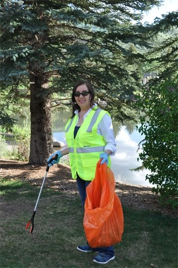 Woman Cleaning Up Trash in Avon