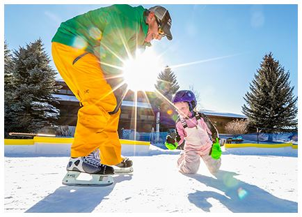 Man helping little girl ski
